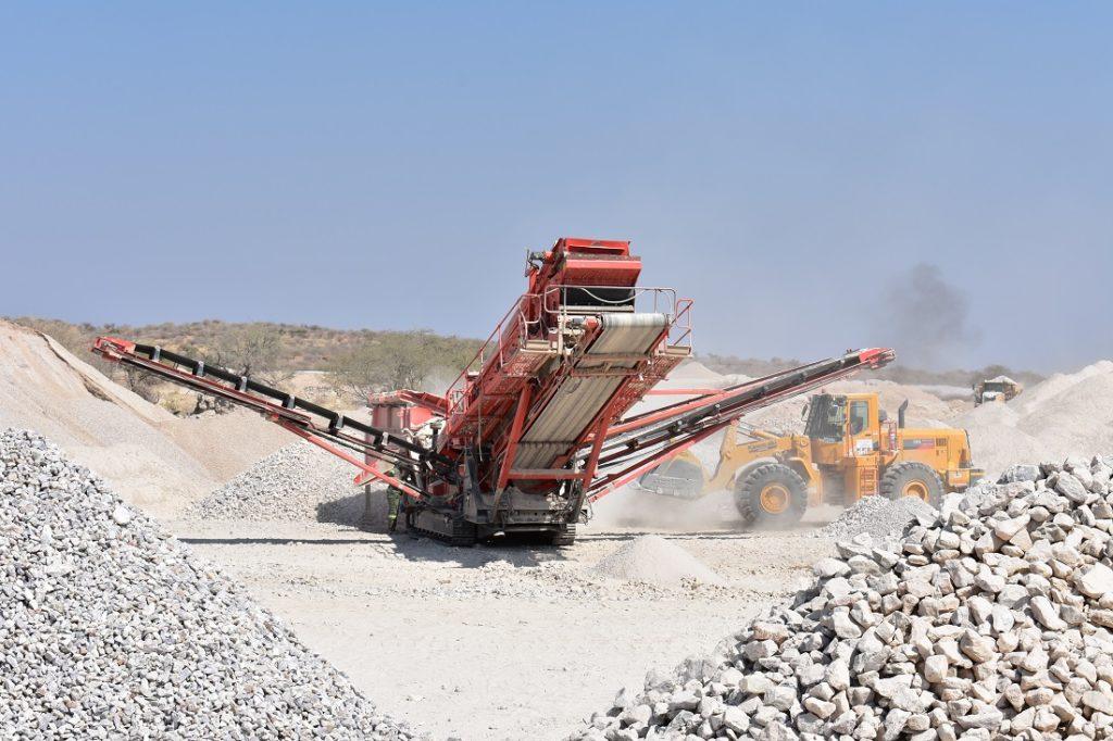 Desert Lion Energy uses mobile equipment to crush surface stockpiles at their lithium deposit close to Karibib.