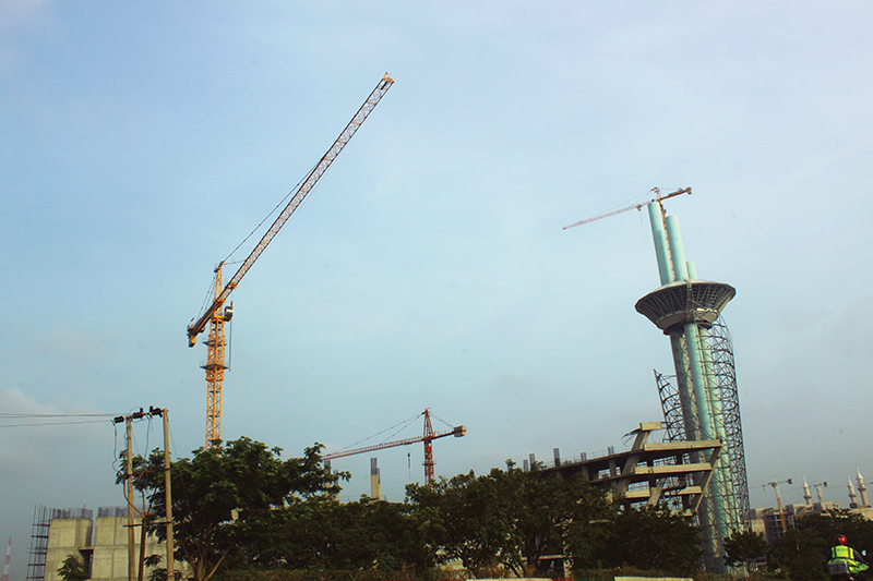 Construction in Abuja, the capital of Nigeria. Nigeria's economy is slowly growing after a period of stagnation. Image credit: Leon Louw
