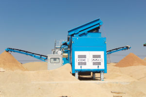 Conveyors deposit river sand and plaster sand to opposite ends of the quarry.
