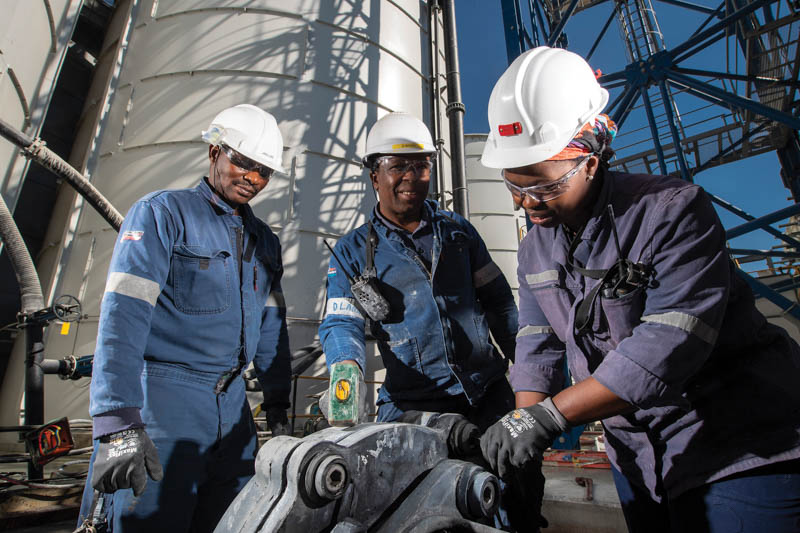 Workers at the Pan African Resources treatment plant. Photo by PAR